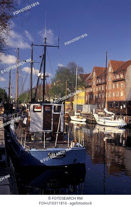 Copenhagen, Denmark, Scandinavia, Sjaelland, Europe, Boats docked along a canal in the scenic city of Copenhagen