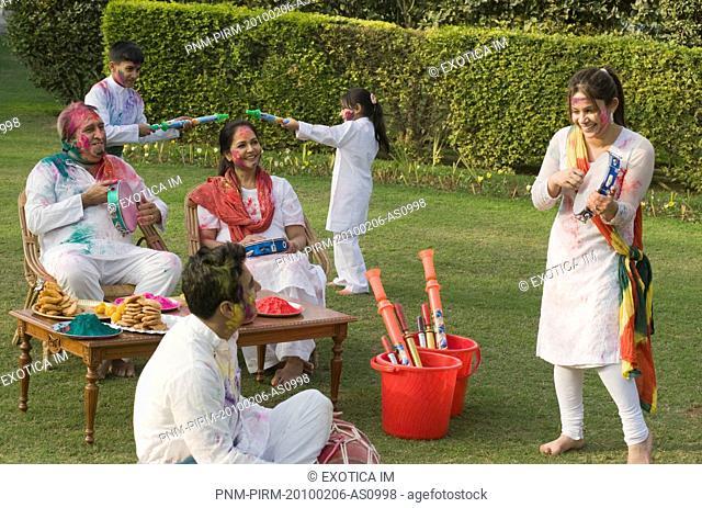 Family celebrating Holi