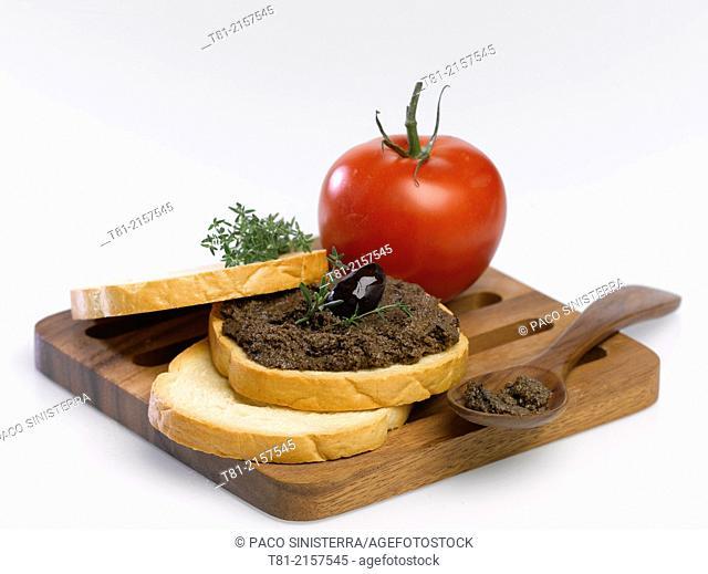 Toast black olive pâté