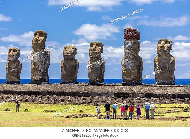 Tourists at the 15 moai restored ceremonial site of Ahu Tongariki on Easter Island (Isla de Pascua, Rapa Nui), Chile