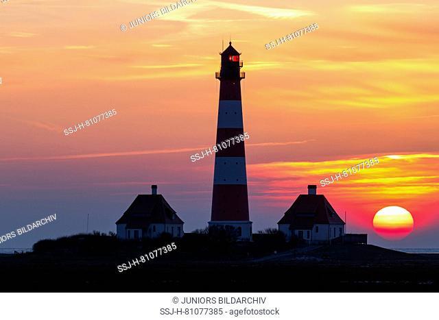 The lighthouse Westerheversand at sunset. Peninsula of Eiderstedt, North Frisia, Germany