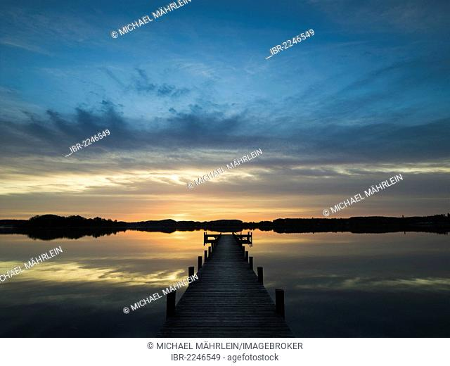 Sunrise, a jetty on Lake Woerthsee, Bavaria, Germany, Europe
