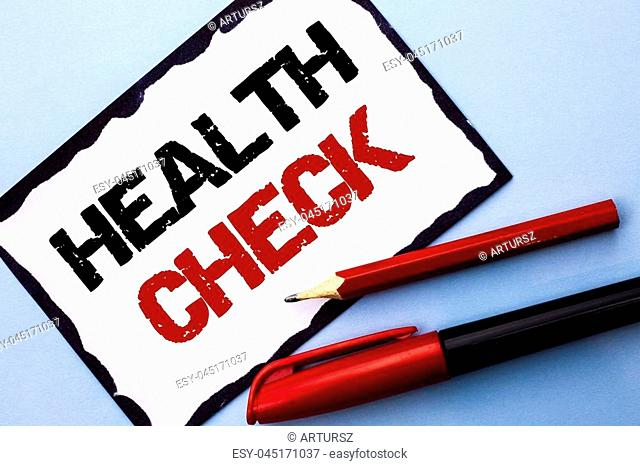 Conceptual hand writing showing Health Check. Business photo text Medical Examination Diagnosis Tests to prevent diseases written White Sticky Note Paper the...