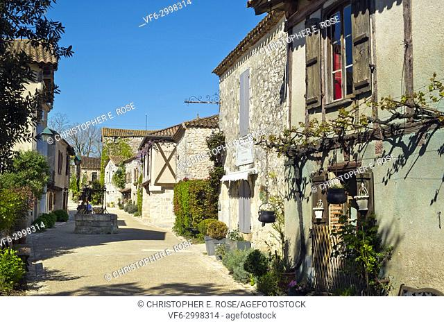 "A picturesque street in spring morning sunshine in Pujols, Lot-et-Garonne, France. This historic village is now a member of """"Les Plus Beaux Villages de..."