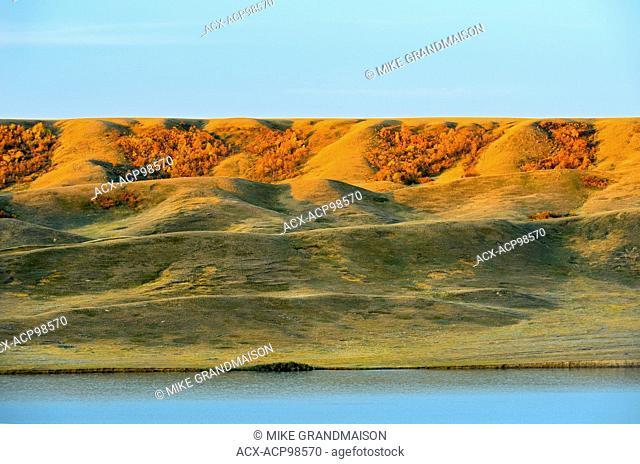 South Saskatchewan River and surrounding hills in autumn at sunrise Saskatchewan Landing Provincial Park Saskatchewan Canada