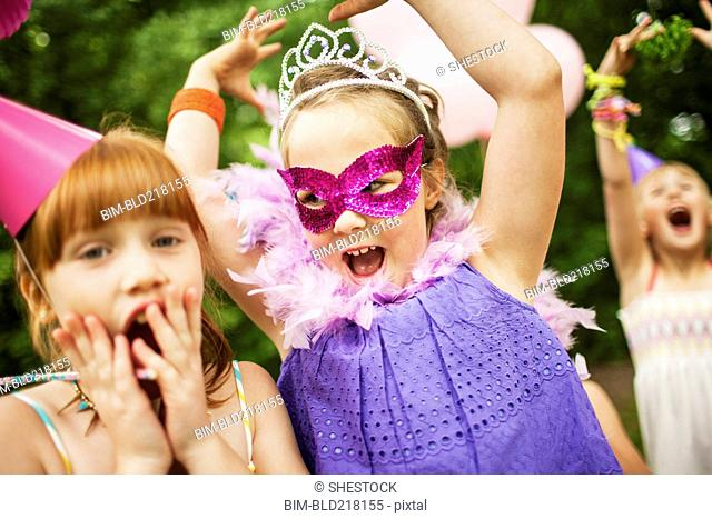 Girls playing dress-up at birthday party