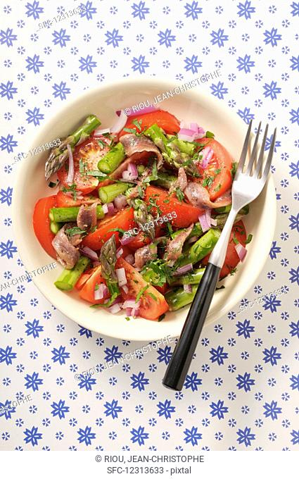 Tomato salad with green asparagus and anchovies