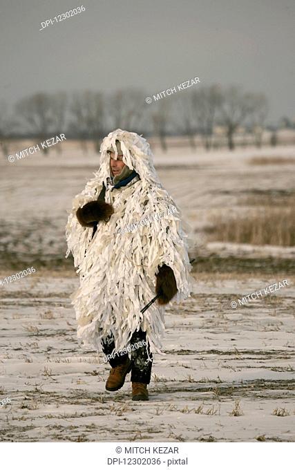 Varmint Hunter In Ghillie Snow Suit