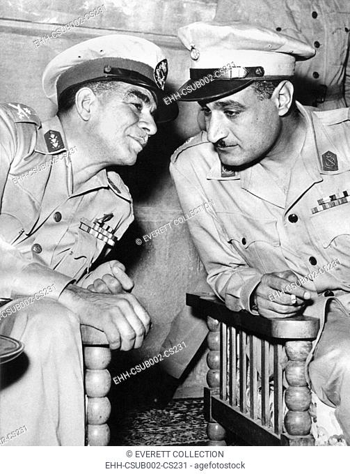 Egypt's strongman premier Muhammad Naguib (left) talking with Lieut. Col. Gamal Abdel Nasser. Shortly afterward, on June 18, 1953