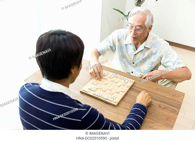 A father and son playing shogi