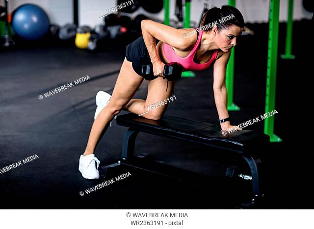 Woman exercise with dumbbells