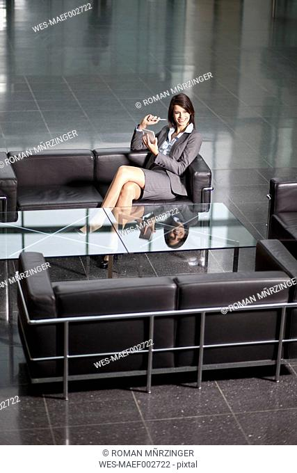Germany, Bavaria, Business woman with PDAs