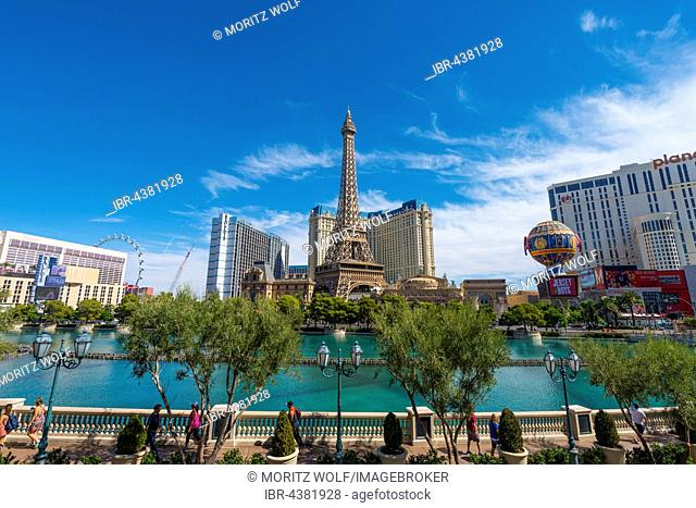 Replica of Eiffel Tower, Paris Hotel and lake in front of Bellagio Hotel, Las Vegas, Nevada, USA