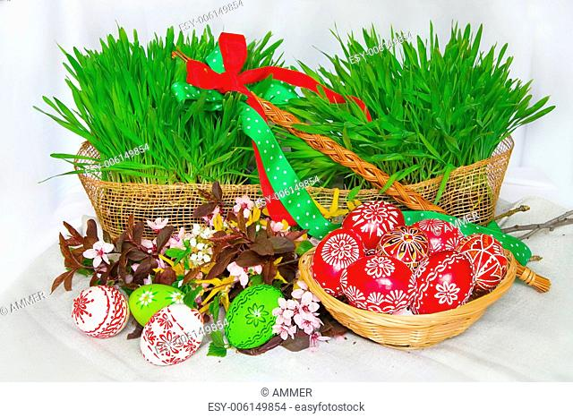 Easter Arrangement with decorated eggs and young green corn
