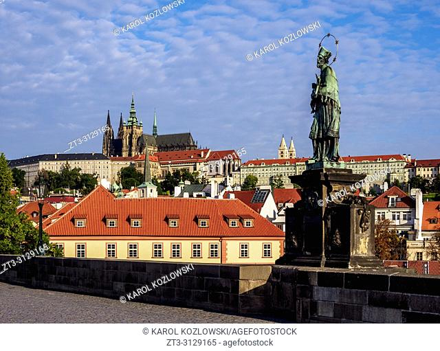 Sculpture at Charles Bridge, Castle and Cathedral in the background, Prague, Bohemia Region, Czech Republic