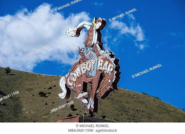 Cowboy sign on a pub, Jackson Hole, Wyoming, USA