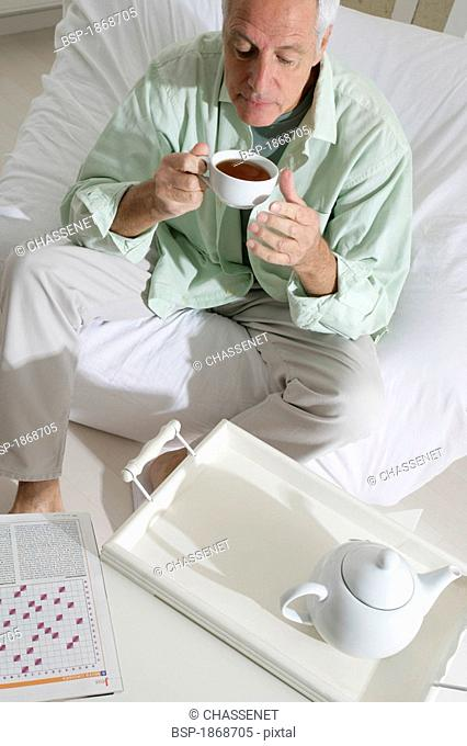 ELDERLY PERSON WITH HOT DRINK Model