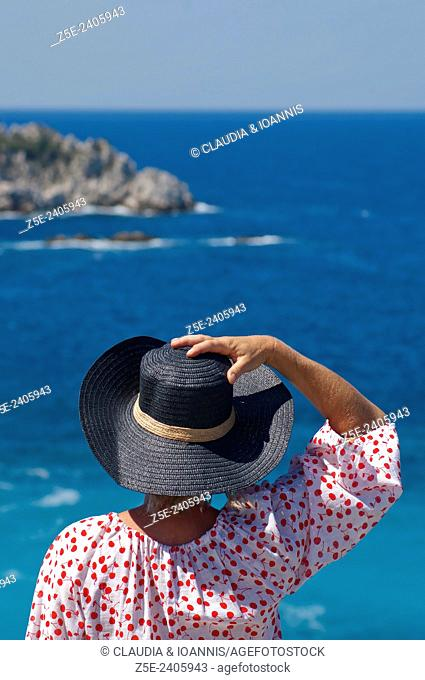Rear view of a woman overlooking the sea on Pelion Peninsula, Thessaly, Greece