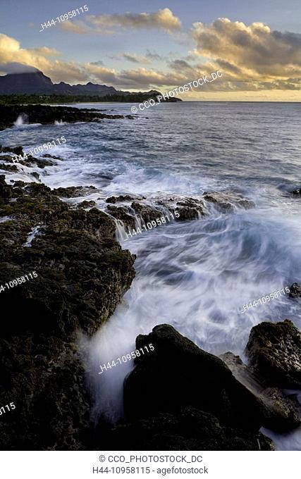 The sea cliffs and surf at sunrise near Shipwreck Beach in Poipu, Kauai, Hawaii. Winter