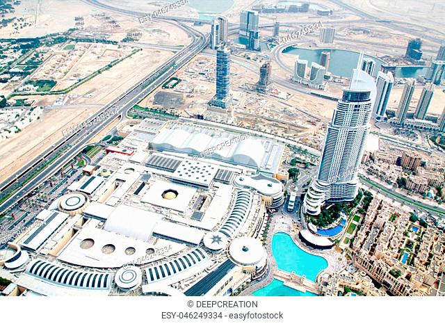 Aerial view of Downtown Dubai with Dubai Fountain and skyscrapers from the tallest building in the world