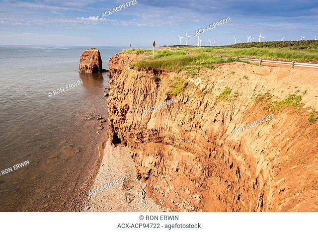 Red shoreline and windmills at North Cape, Prince Edward Island, Canada