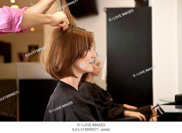 A female client having a blow dry in a hairdressing salon