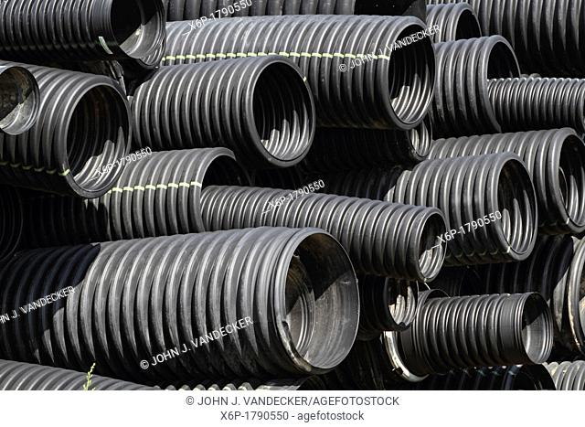 A closeup of a stockpile of flexible construction conduits  Lyndhurst, New Jersey, USA