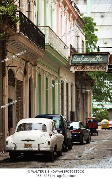 Cuba, Havana, Havana Vieja, morning view of Old Havana street with 1950s-era US car
