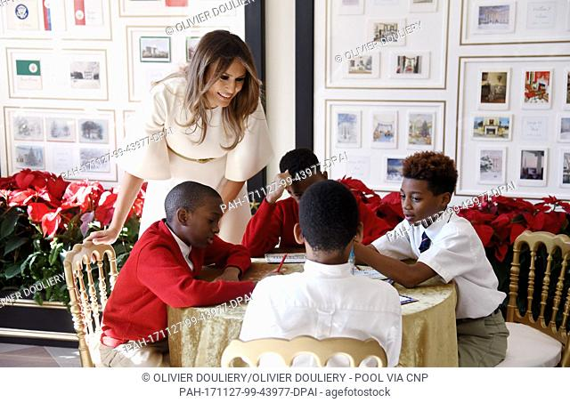 First Lady Melania Trump participates in arts and crafts projects with children and students from Joint Base Andrews in the Booksellers area of the White House...