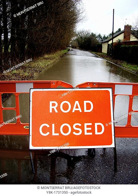 Flooded country road with road closed sign in Thurston Bury St Edmunds, Suffolk, UK