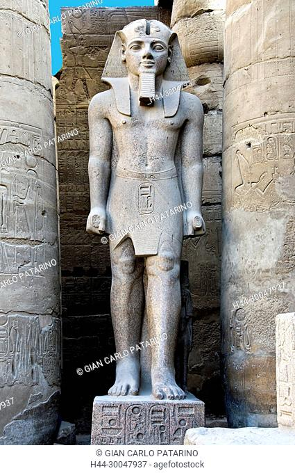 Luxor, Egypt. Temple of Luxor: a giant statue of the pharaoh Ramses II (1303-1212 b.C.) in the courtyard