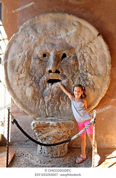 nice young girl puts her hand inside the Bocca della Verit?, Rome 4