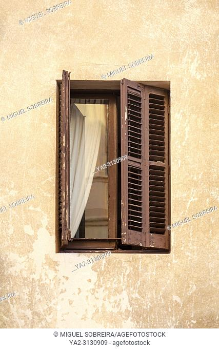 Small Open Window With Shutters