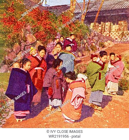 This scene in Japan dates to 1909. It shows babies on the babies of their big sisters