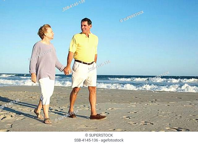 Couple walking on the beach, Far Rockaway, Queens, New York City, New York State, USA