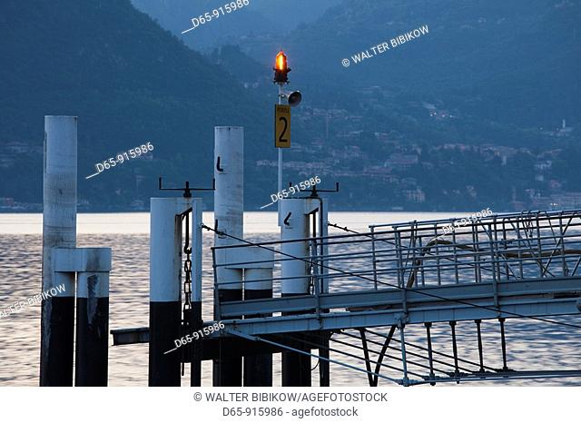 Italy, Lombardy, Lakes Region, Lake Como, Bellagio, lakeside ferry dock, dusk