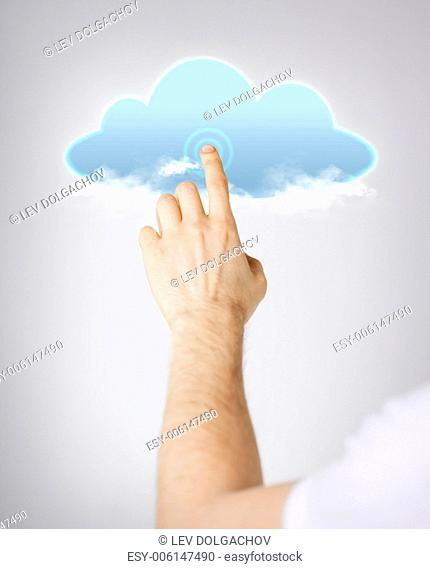modern technology and cloud computing concept - closeup of man hand pointing at cloud