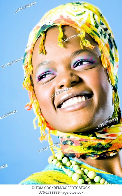 Young African woman portrait with scarf