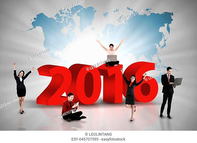 Happy business team work on the year 2016. Business team concept