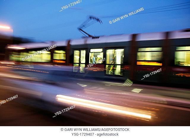 fast metro tram carriage on tracks in city at night rome italy