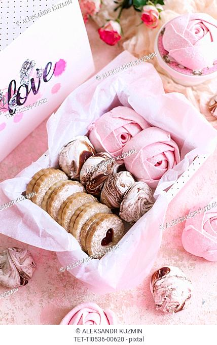 Pink box of biscuits and candy