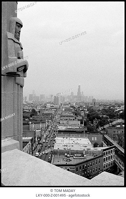 Chicago skyline as seen from distant building adorned with relief sculpture
