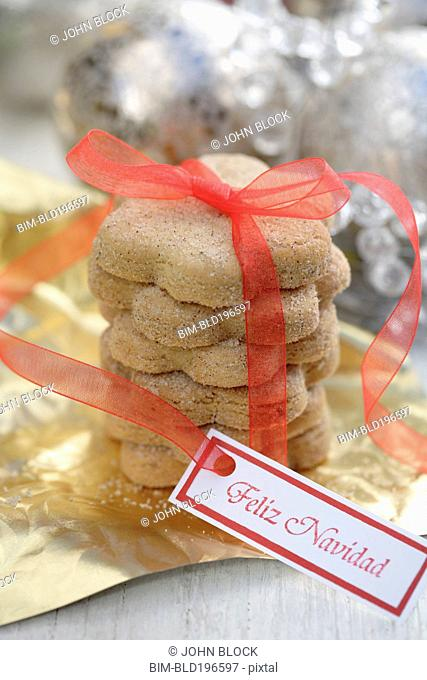 Christmas cookies tied with red ribbon