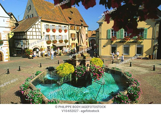 Pope Léon IX square with a fountain in the foreground, Eguisheim, Haut-Rhin, Alsace, France