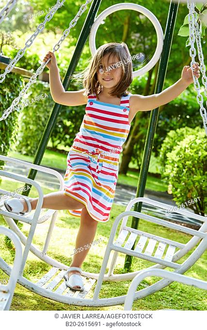 Girl playing in the park. Getaria. Gipuzkoa. Basque Country. Spain