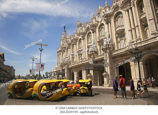 Coco taxis and old American cars in front of the colonial Great Theater-Gran Teatro at Center Havana, La Habana, Cuba, Central America