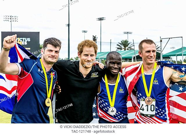 David Henson, of the United Kingdom, along with Allan Armstrong and William Reynolds of the USA, pose with Prince Harry after he presented them with their...