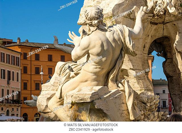 Statue in a water fountain in piazza Navona in a sunny day in Rome, Italy