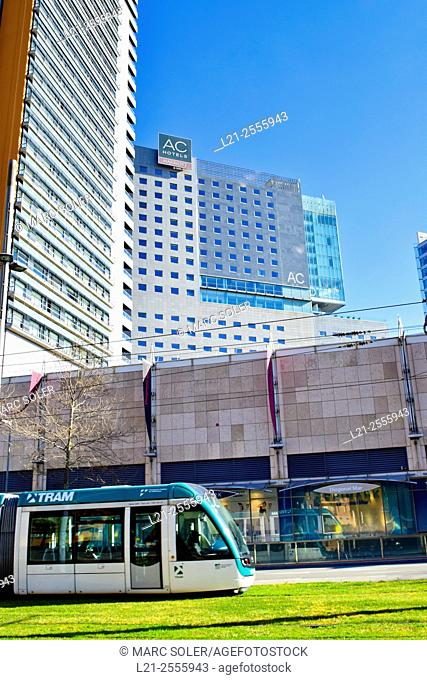 Tram in Diagonal Avenue, Hotel Barcelona Princess and AC Hotel Barcelona Forum in background, Forum area , Barcelona, Catalonia, Spain