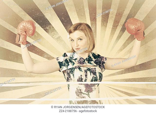 Vintage portrait of a tough boxer girl wearing gloves when flexing muscles in old style boxing ring. Strength and conditioning